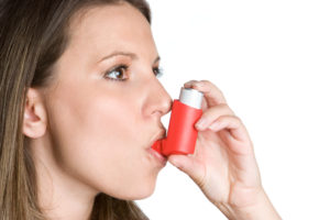 Woman Taking Inhaler